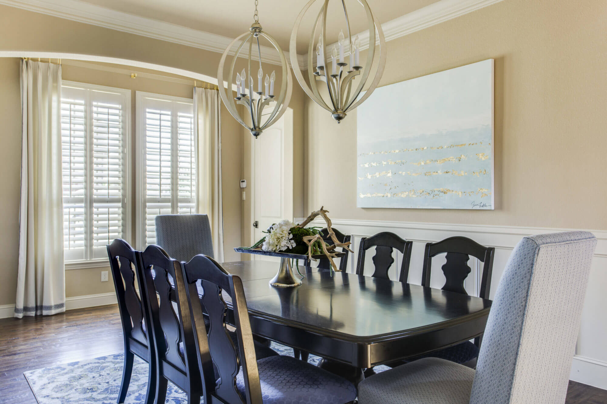 Formal Dining Room With White Crown Molding Sand Colored Accent Walls Custom Art And