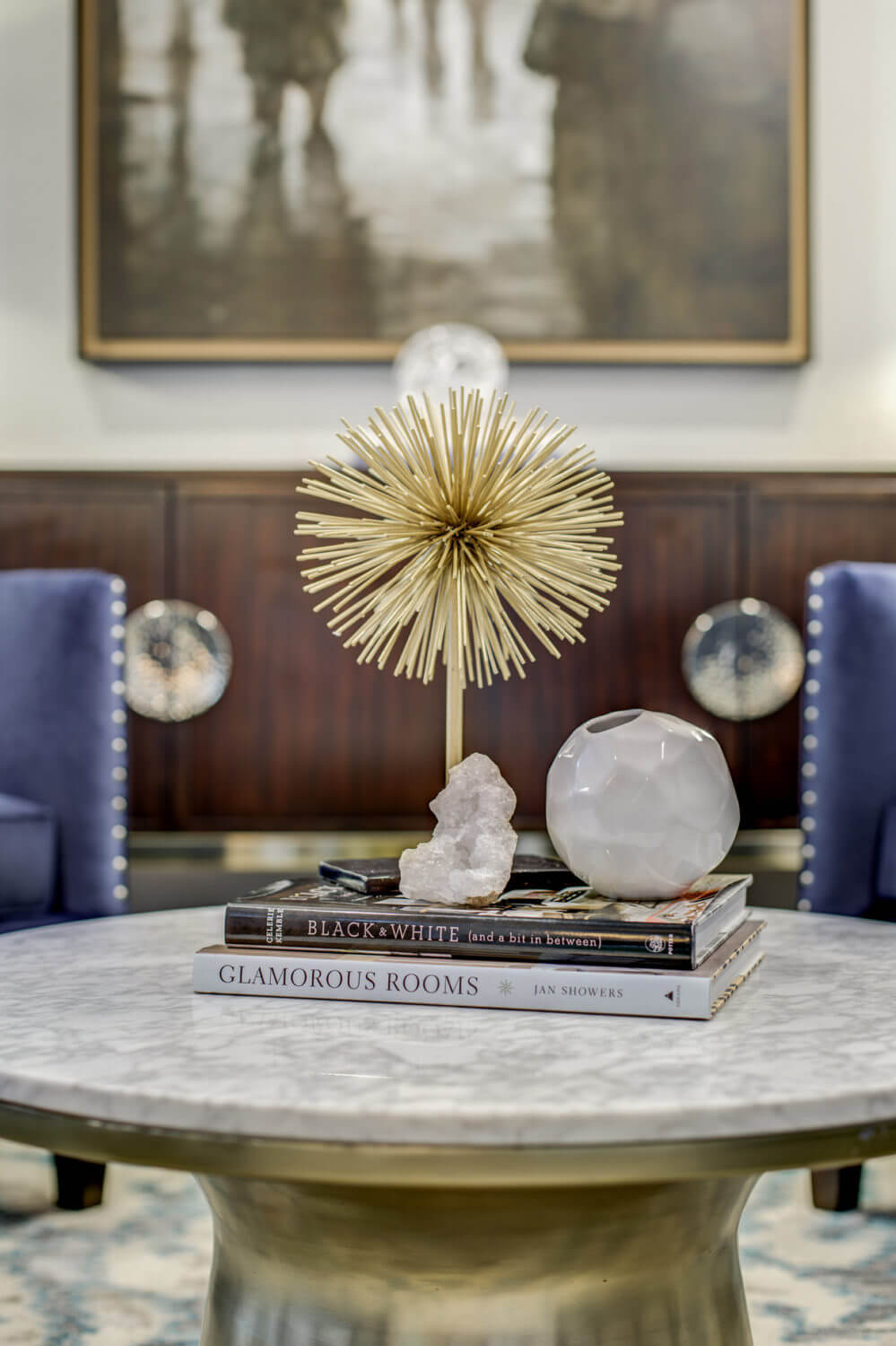 Formal Living Room With Brass And Marble Coffee Table Decorative Books