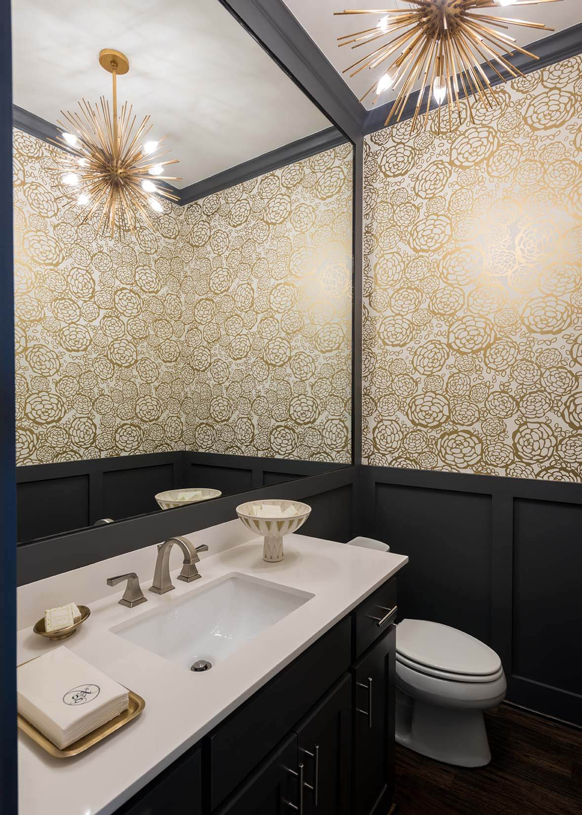 A bold powder bathroom wallpaper increases the glamour factor in this gorgeous Dallas new build. | ML Interiors Group is an interior design firm specializing in making homes happier and more efficient.