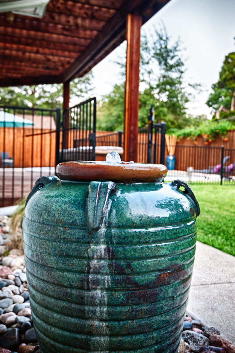 Outdoor water feature with a teal, worn finish. | ML Interiors Group