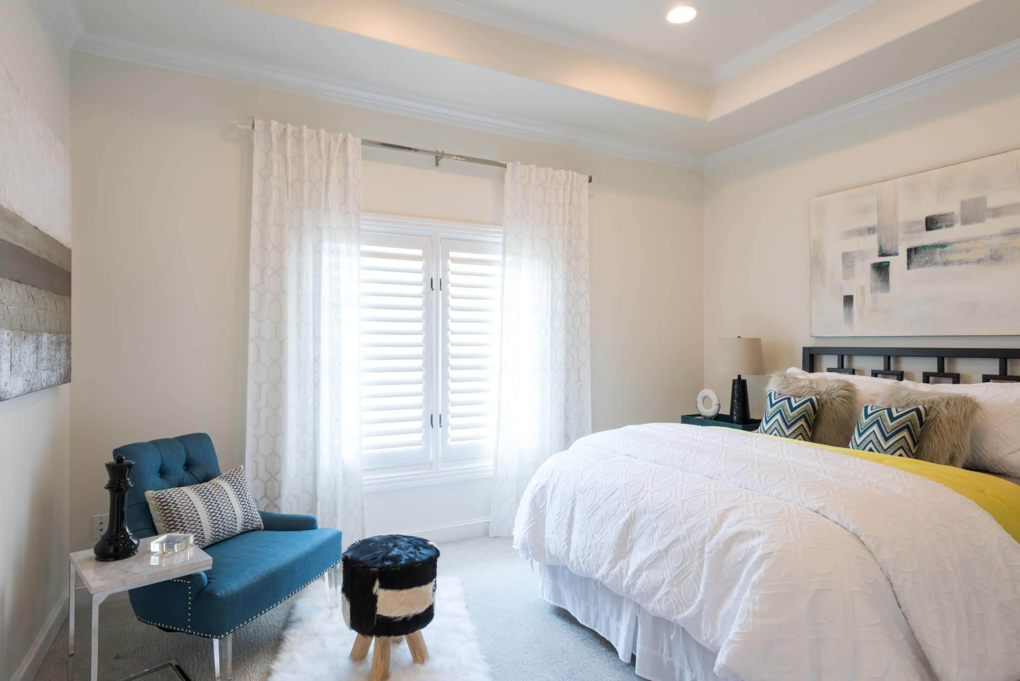Create a guest bedroom that welcomes your loved ones | Include curtains over privacy windows for texture | Dallas Interior Designer | ML Interiors Group