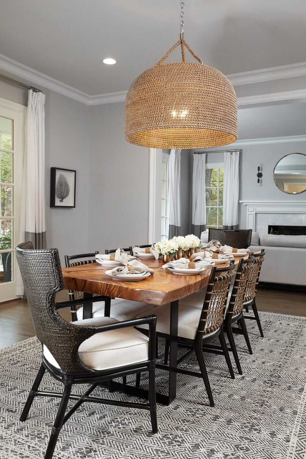 Formal dining never looked so good. Live edged table, oversized Palacek chandelier and comfortable and stylish chairs welcome guests to stay and enjoy a meal. | Midway Hollow | Interior Design firm ML Interiors Group