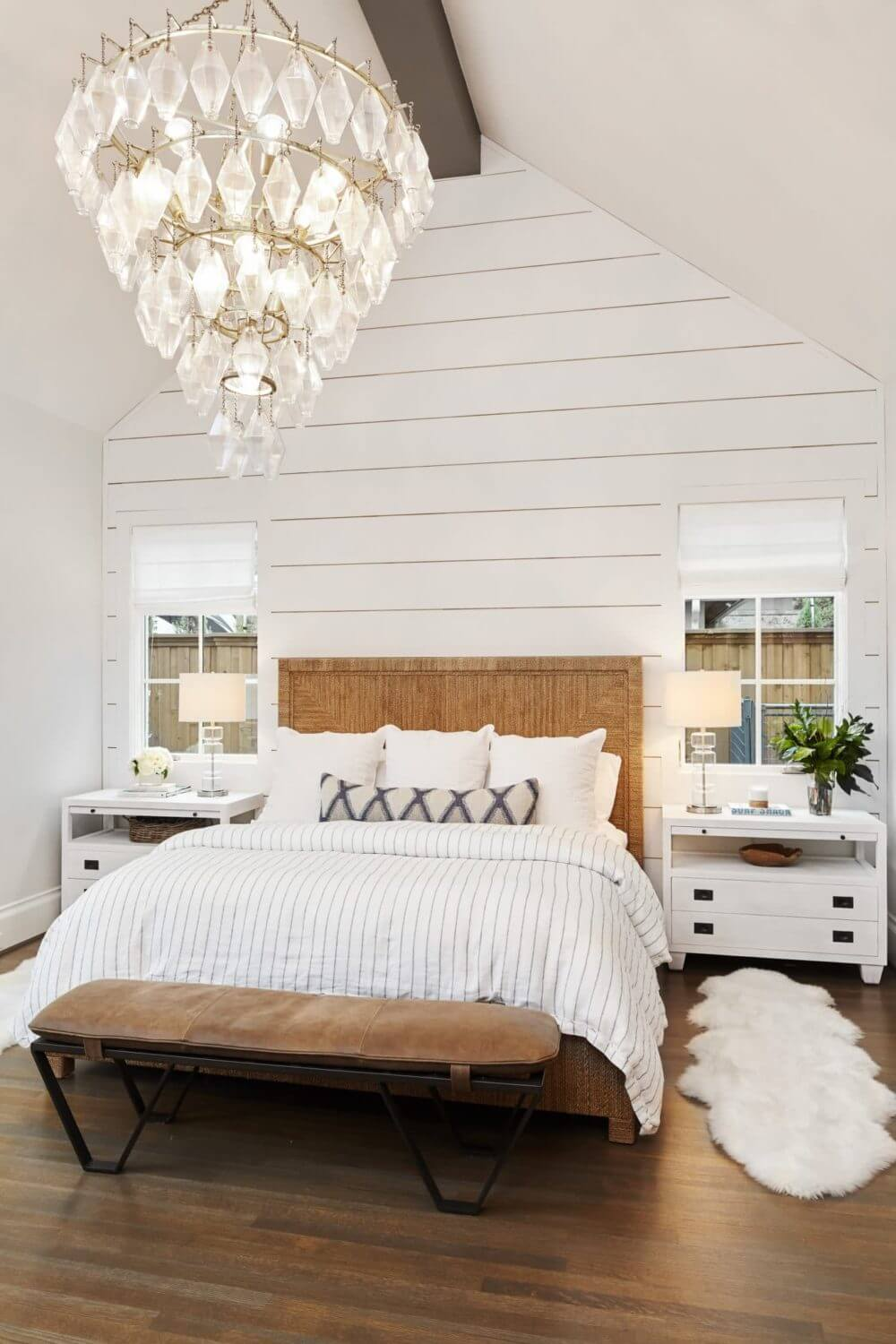 Master bedroom design created by ML Interiors Group of Dallas, Texas | Statement chandelier | Textured bed | Shiplap