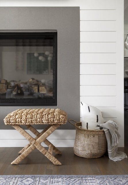 Shiplap, cozy blankets, basket and natural seating with double sided fireplace | Midway Hollow Interior Design | Dallas | ML Interiors Group