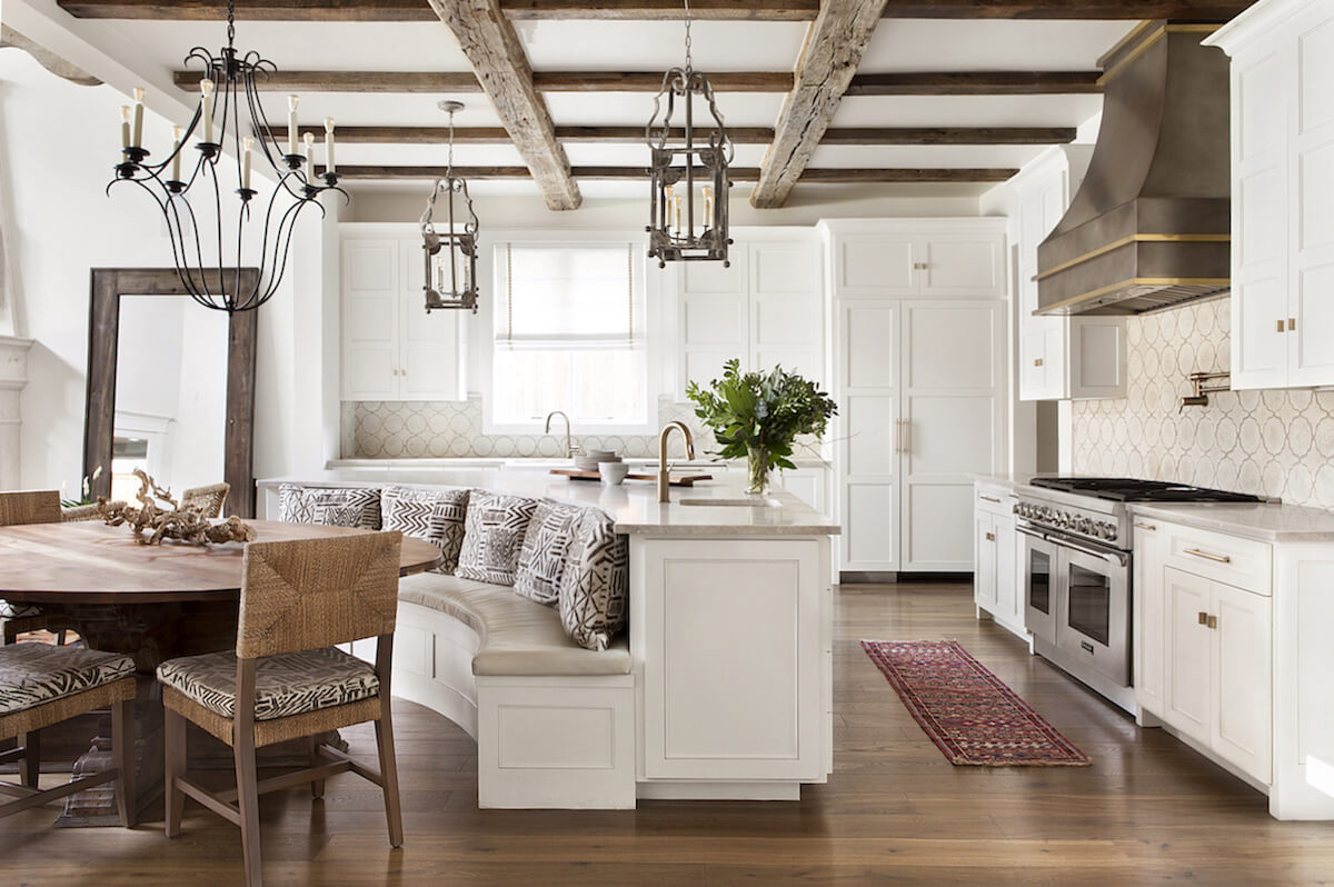 Lakewood neighborhood new construction kitchen with reclaimed beams, antique lanterns and custom hood   Interior Design Dallas   Michelle Lynne Interiors Group